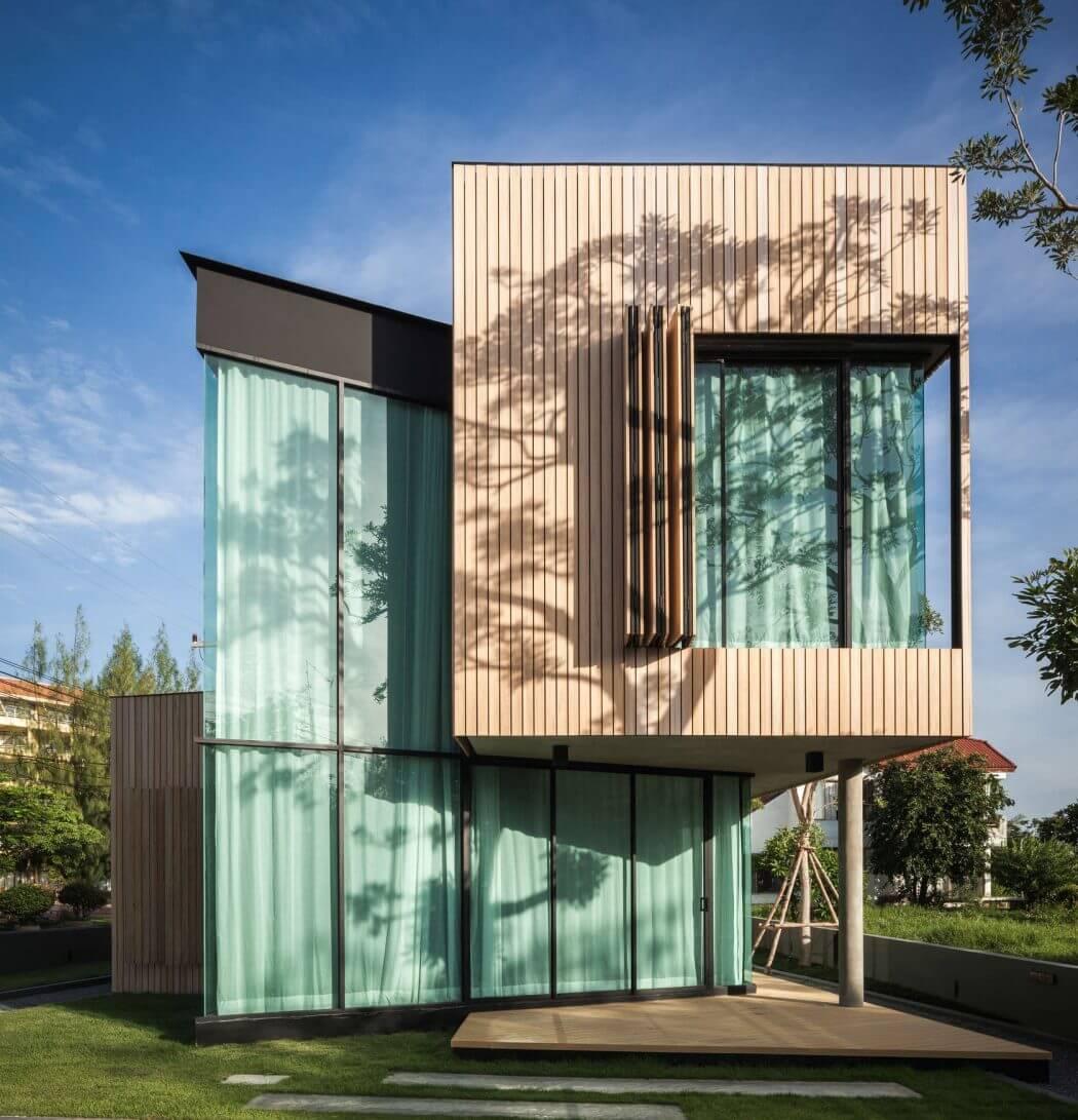 fachada-de-vidro-e-madeira-em-angulo-por-idin-arquitetura
