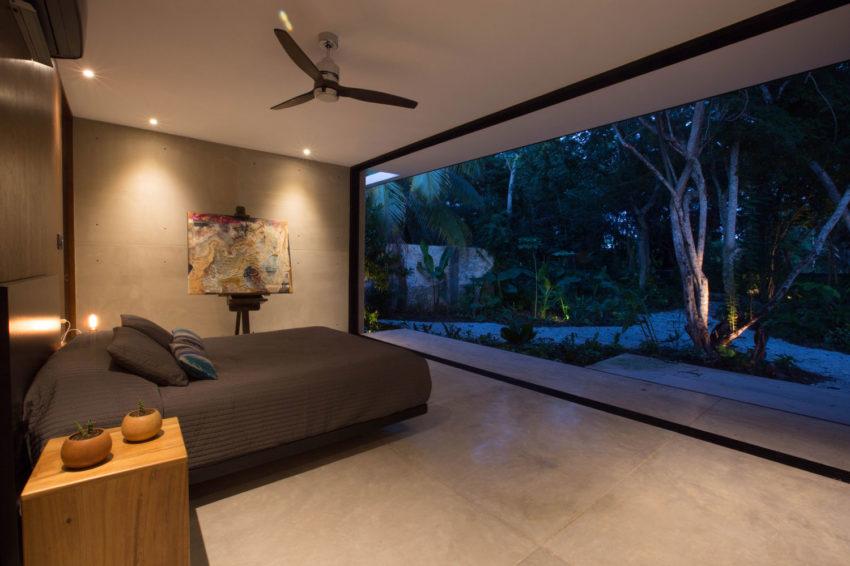 Suíte Integrada ao Jardim por FGO Arquitetura
